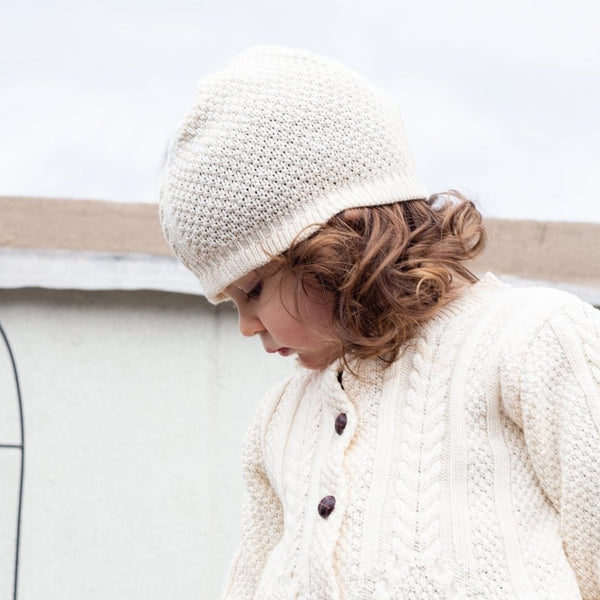 "This lightweight hat is super versatile. Pair with our ""Girl's Classic Aran Knit Button Front Cardigan"" for a great outfit!by a soft idea"
