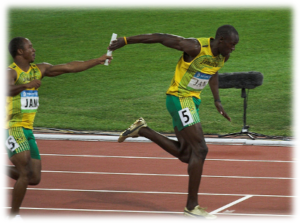 Usain Bolt receiving baton during 2008 olympics