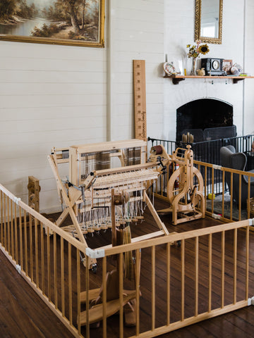 Mum jail this darling home - wheels and loom placed within a play pen