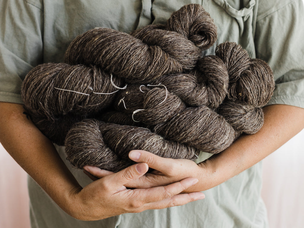 this darling home skeins of brown/grey handspun wool yarn. It was spun for a commission and is destined to be woven into a scarf