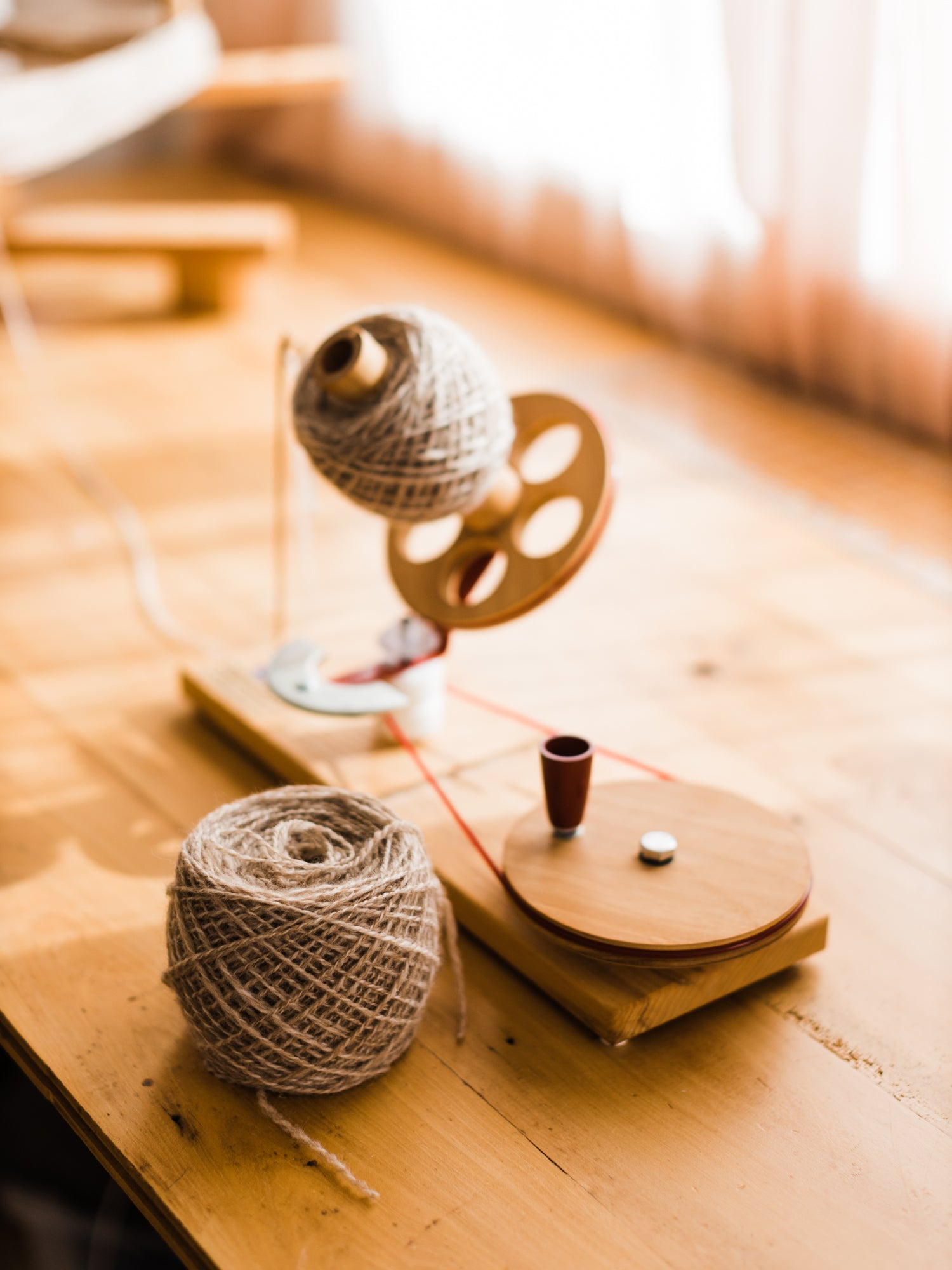 This Darling Home Handspun yarn wound on a ball winder