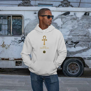 Adult black male model wearing a Black personalised hoodie, with a large gold Ankh symbol on the centre of the hoodie, with the words Ankh, The Key of Life with a small BTMR Round Logo underneath. Model has his hand in his pockets, and is wearing sunglasses