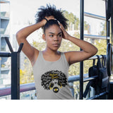 BlackToMyRoots Melanin Queen Grey Tank top worn by a black young women in a gym. T Shirt features a design of a Black Woman silhouette with a large natural afro, which has positive words embedded in the afro. Underneath is the BlackToMyRoots logo - a solid black circle with the initials BTMR in the centre. Model is about to put her hair into a bunch. -