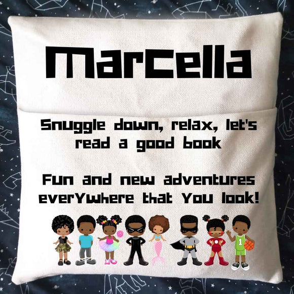 White personalised Reading Book Cushion. Features a 45*45cm cushion with a pocket at the front. This personalised reading book pocket cushion features the phrase - Snuggle down, relax. let's read a good book. Fun & New Adventures everywhere that you look.