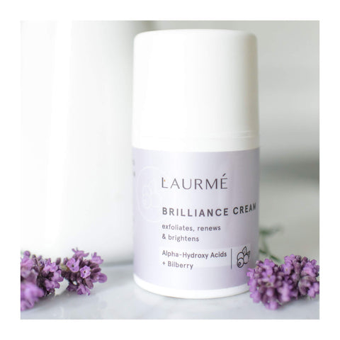 brilliance cream sitting next to lavender petals