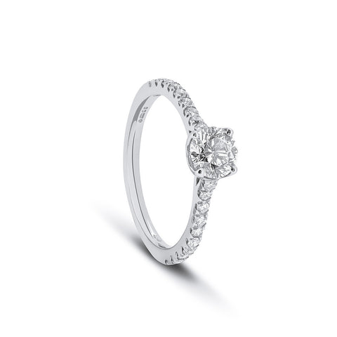 Half carat round diamond with micro pavé shoulders