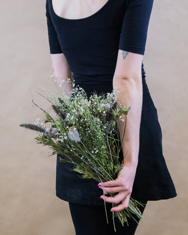 Girl holding a dried bouquet of flowers