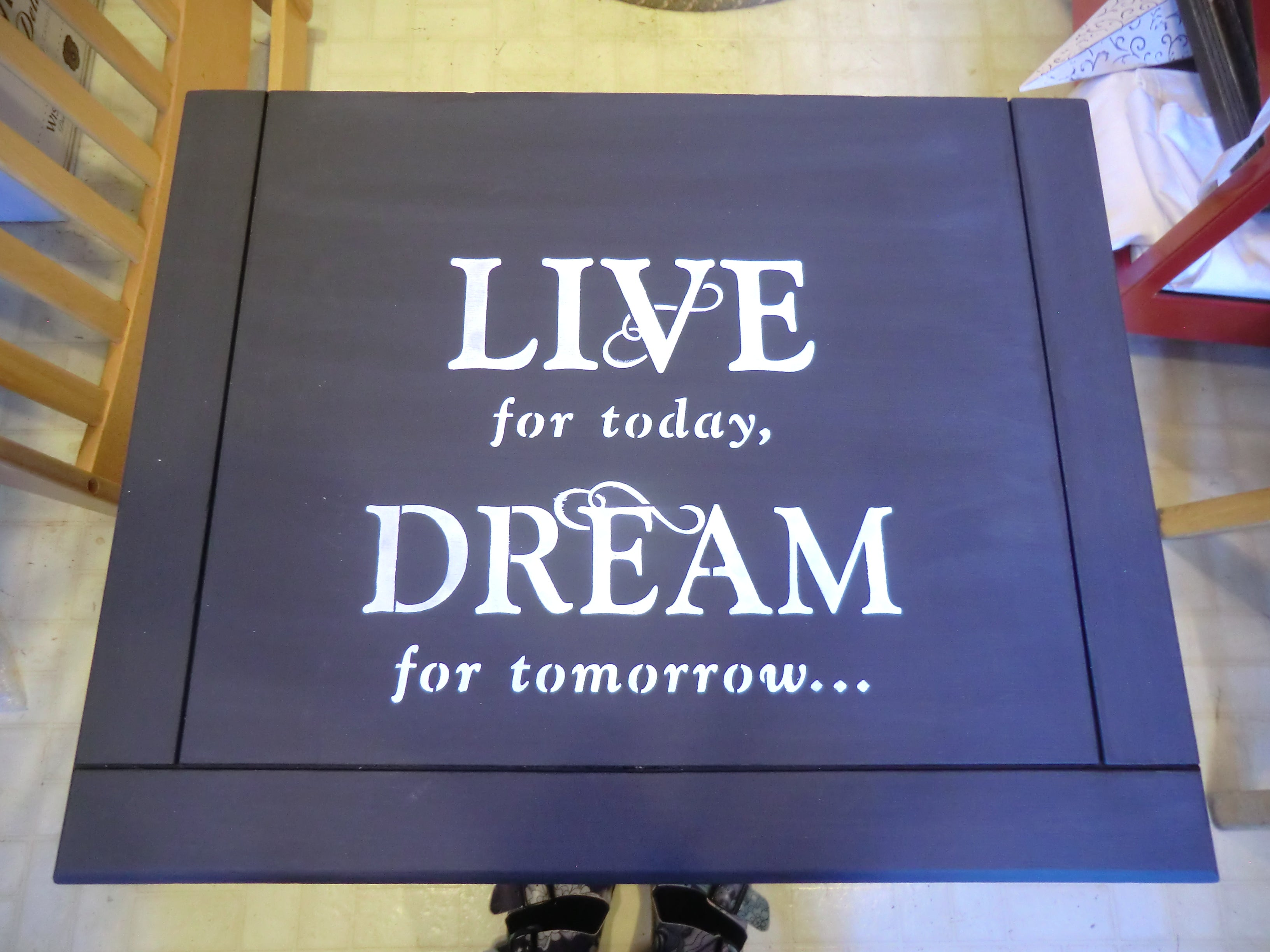 Live for today, dream for tomorrow stencilled saying on Nightstand