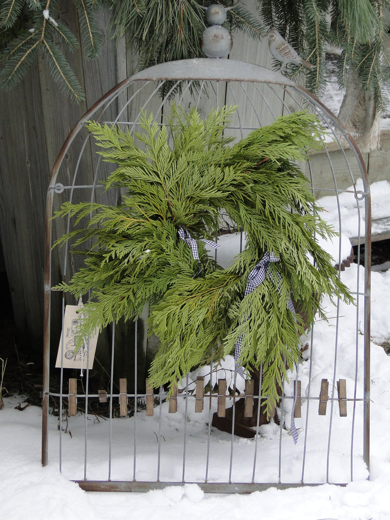 metal holder with cedar wreath