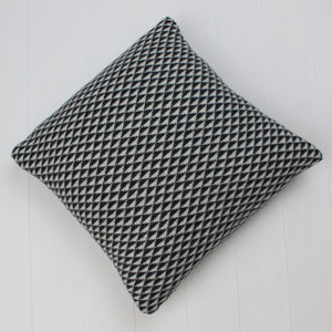 Triangle knitted cushion - monochrome