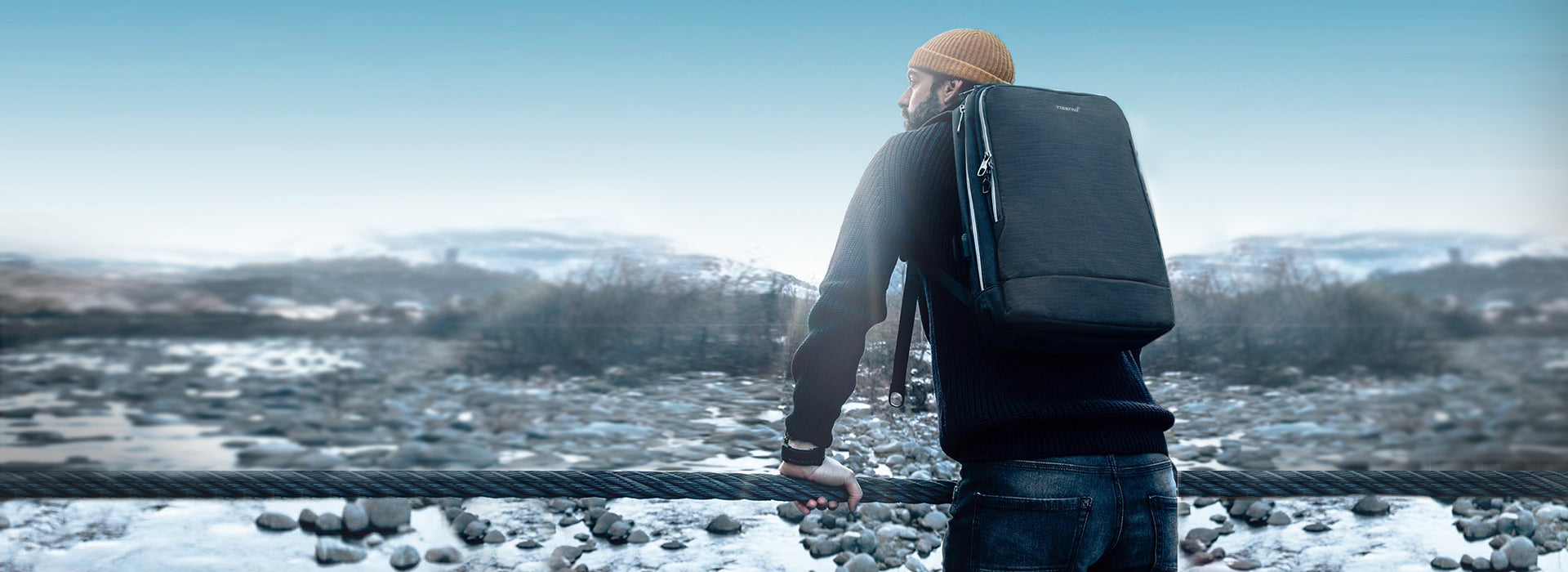 Background image a man with a backpack looks into the distance