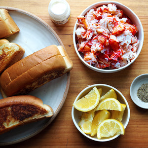 fresh lobster meat and ingredients to prepare lobster rolls