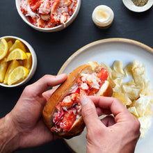 Load image into Gallery viewer, lobster roll being made