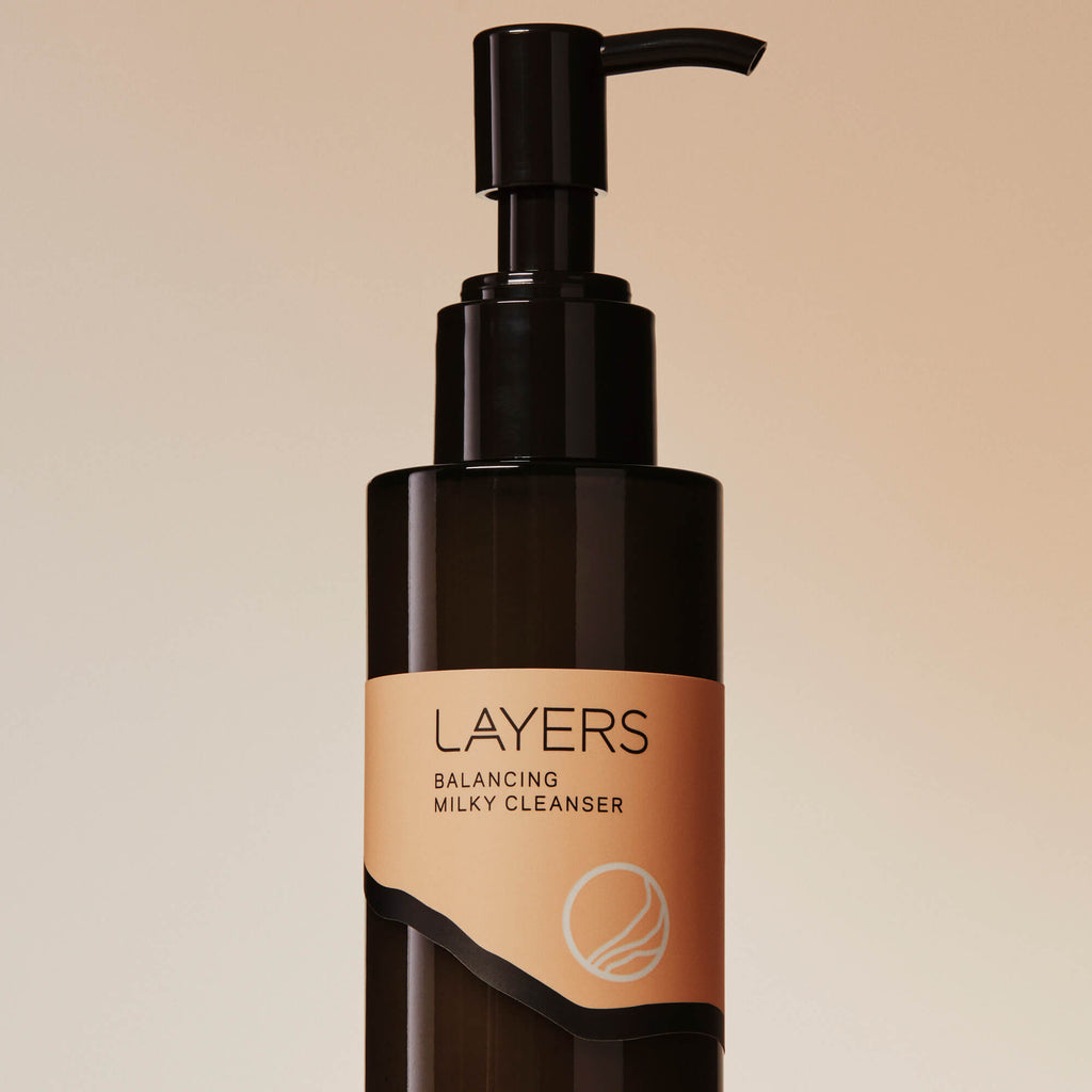 Layers Probiotic Skincare Balancing Milky Cleanser in semi-transparent black glass bottle with pump. For dry, oily, and combination skin.