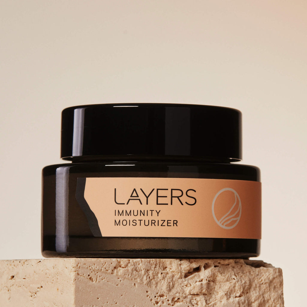 Layers Probiotic Skincare Immunity Moisturizer in semi-transparent black glass jar. For dry, oily, and combination skin.