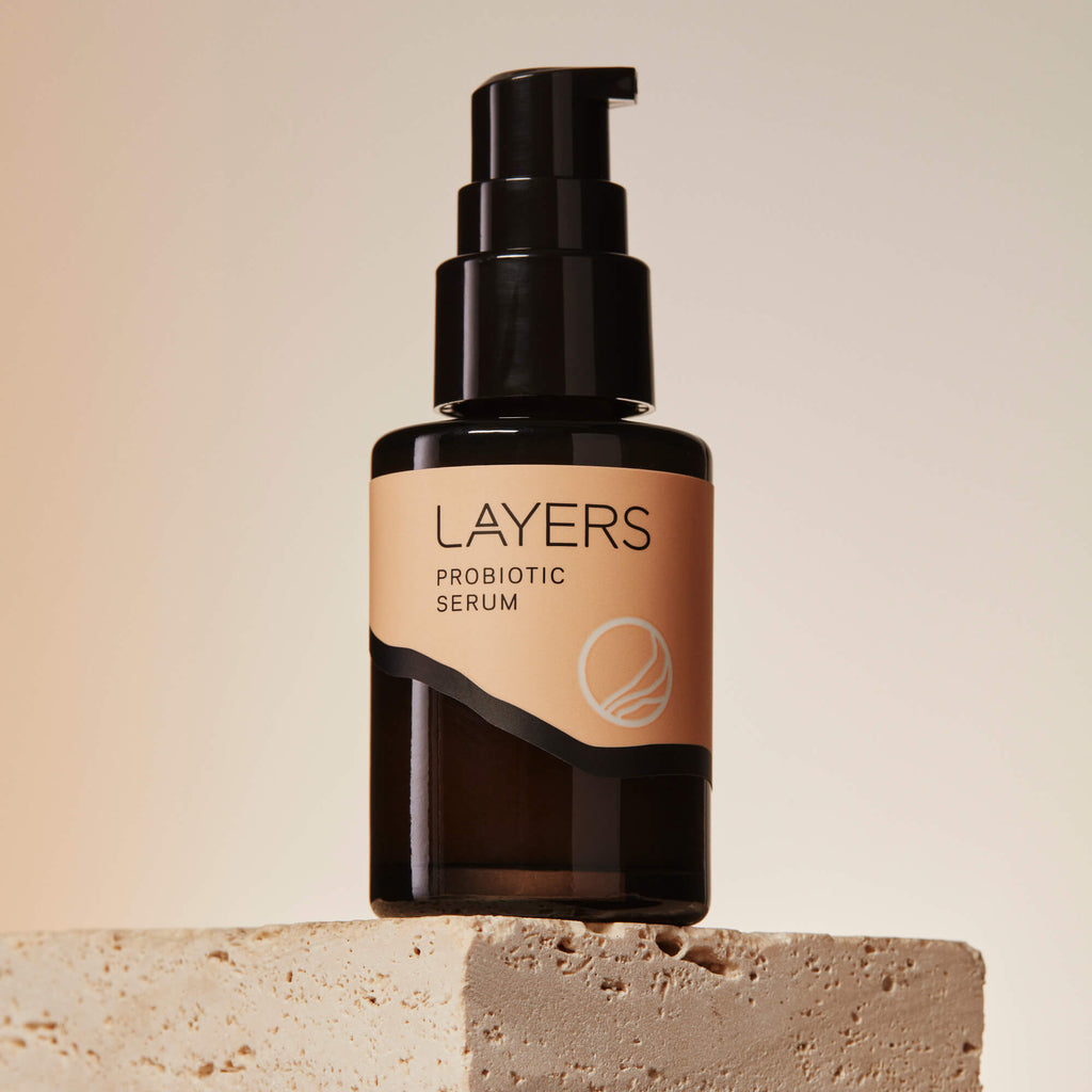 Layers Probiotic Skincare Probiotic Serum. Semi-transparent black glass bottle with pump. For dry, oily, and combination skin.