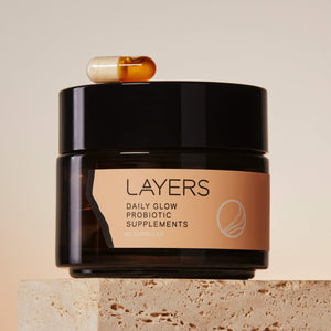 Layers Daily Glow Probiotic Supplements Glass Jar with Dual-Sided Capsule. Works for dry, oily, and combination skin
