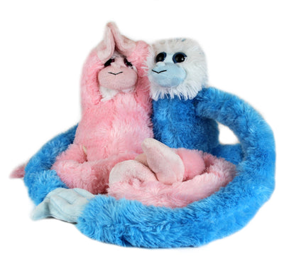 Pink plush monkey and blue plush monkey