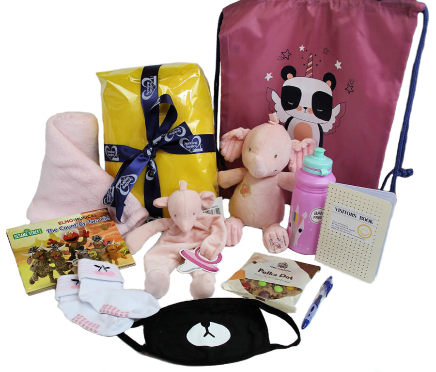 Blanket, book, socks, cookie, bag, teddy with rattle, dummy holder teddy, face mask, drink bottle