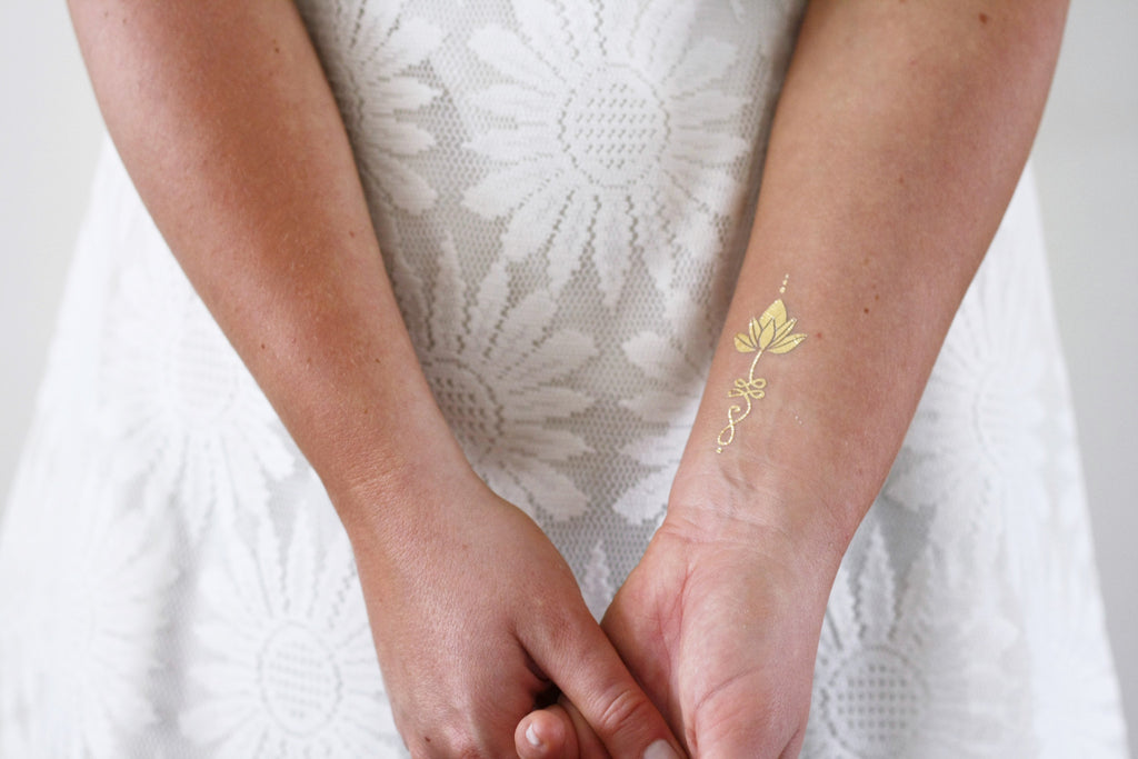 Gold ulanome lotus temporary tattoos - a temporary tattoo by Tattoorary