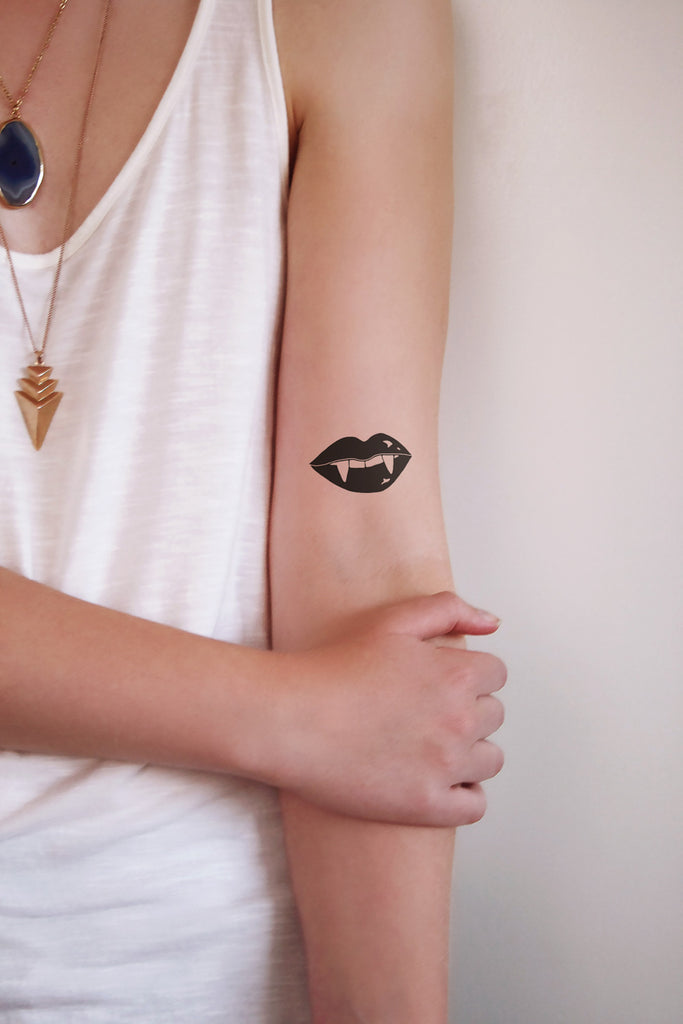 Vampire teeth temporary tattoo - a temporary tattoo by Tattoorary