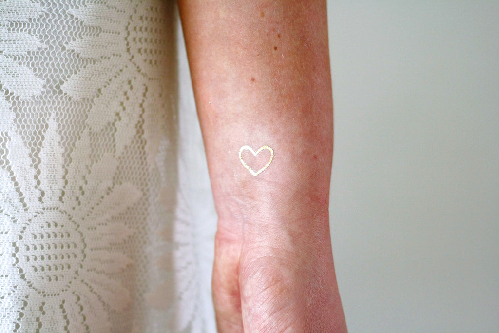 Small gold hearts temporary tattoos - a temporary tattoo by Tattoorary