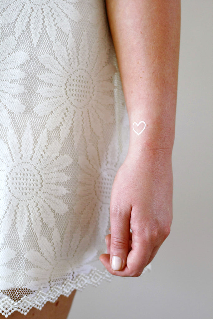 Small white hearts temporary tattoos - a temporary tattoo by Tattoorary