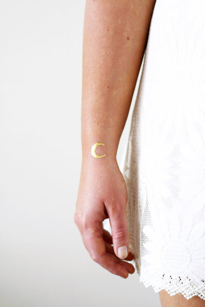 Small gold moon temporary tattoos - a temporary tattoo by Tattoorary