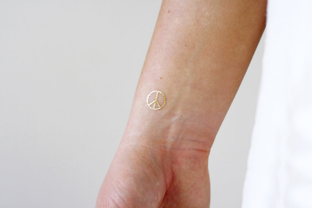 White and gold peace signs temporary tattoos - a temporary tattoo by Tattoorary