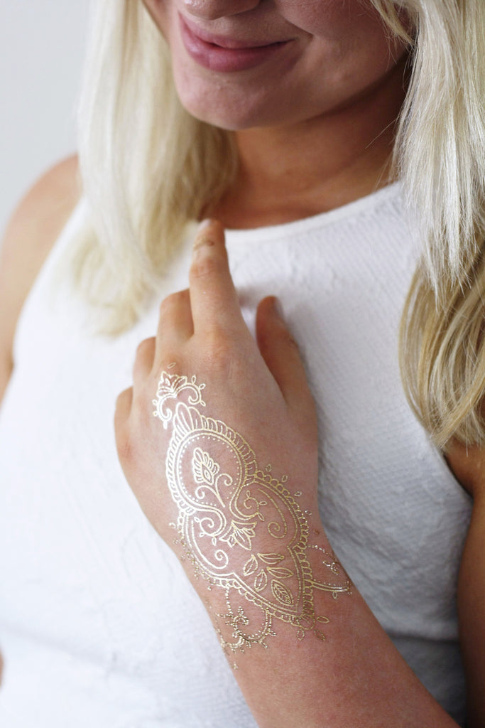 Gold henna hand temporary tattoo - a temporary tattoo by Tattoorary