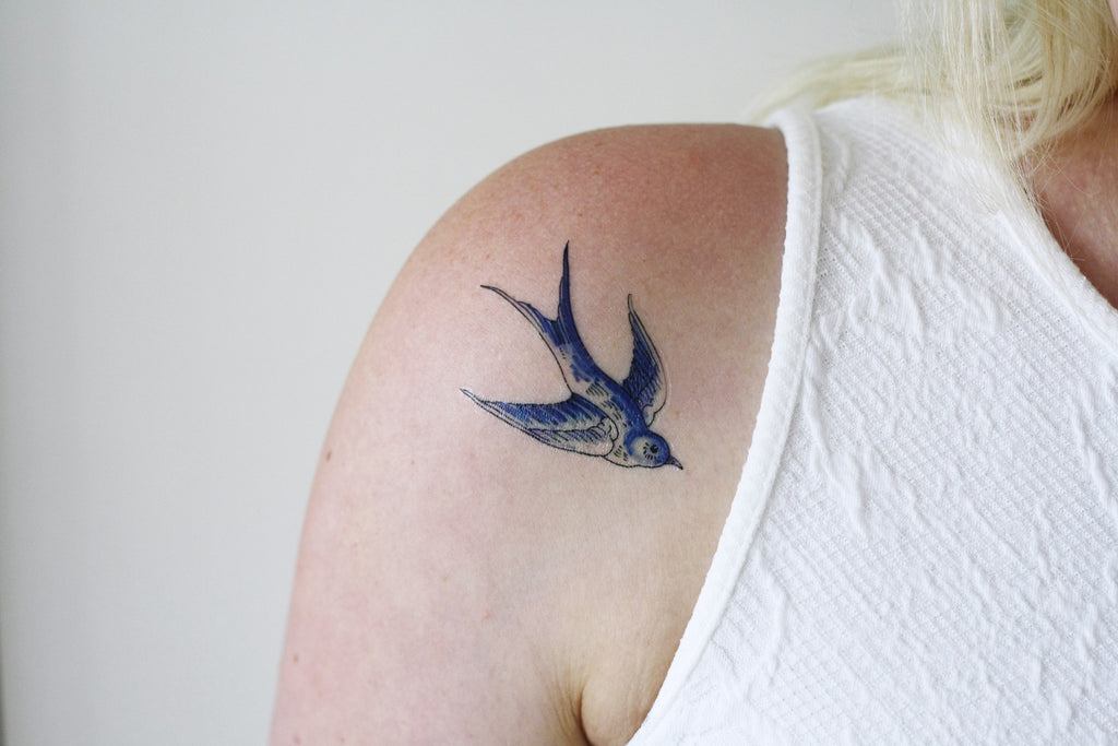 Delfts Blue swallow tattoos - a temporary tattoo by Tattoorary