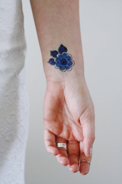 Small Delft Blue flower tattoo - a temporary tattoo by Tattoorary