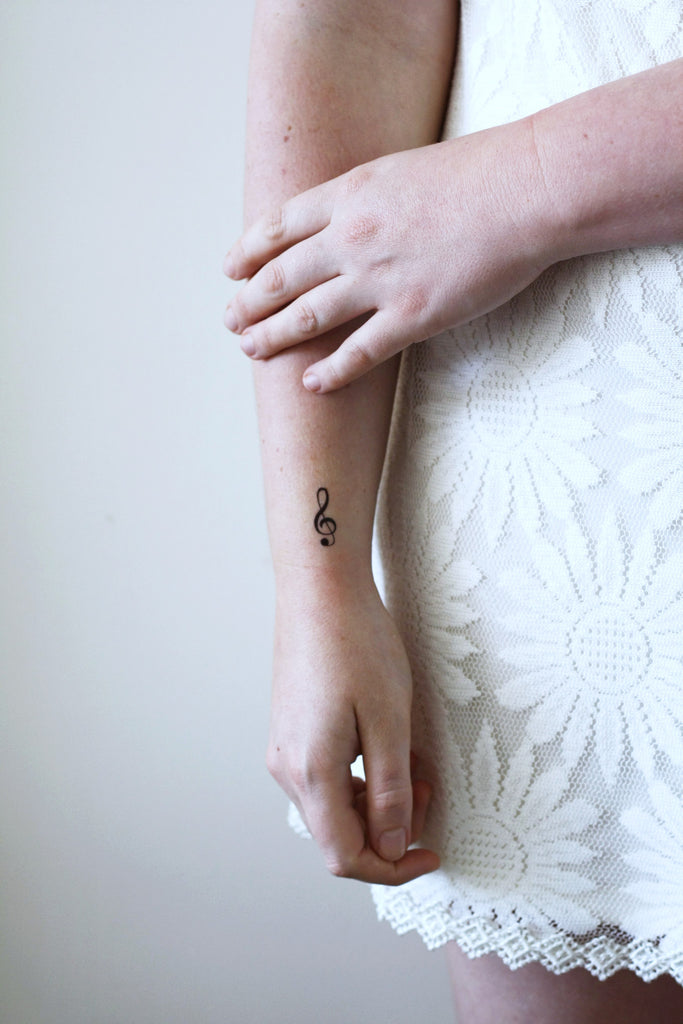 Small G Clef music temporary tattoo (4 pieces) - a temporary tattoo by Tattoorary
