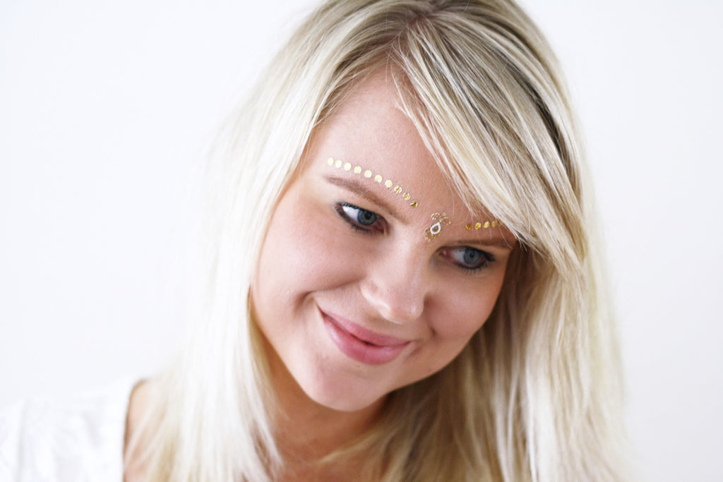 Gold and white face temporary tattoos - a temporary tattoo by Tattoorary
