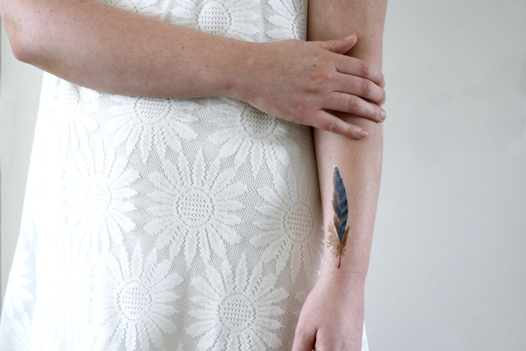 Blue feather temporary tattoo - a temporary tattoo by Tattoorary