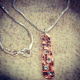 Custom copper pendant with march birthstones.