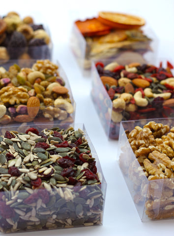 clear boxes of our trail mixes, of dried fruits, nuts and seeds.