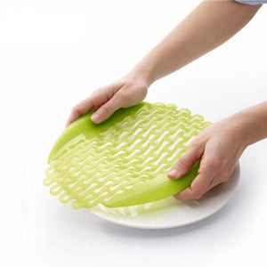Multi-Purpose Silicone Thaw and Veggie Strainer