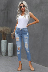 Light Wash Heavily Distressed Skinnies