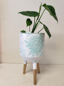 White and teal planter