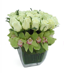 ROSES WITH ORCHIDS IN HORSETAIL VASE