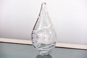 Stylish narrow neck clear vase with white trail