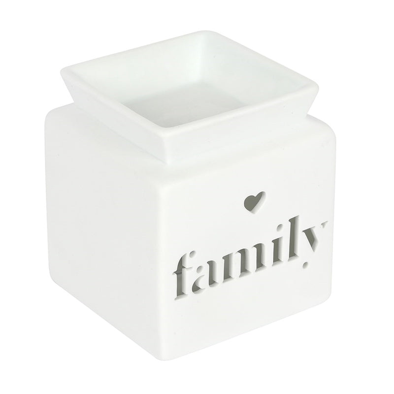 A White Cube shaped Oil and wax melt burner with text cut out family and a small heart cut out above the word family