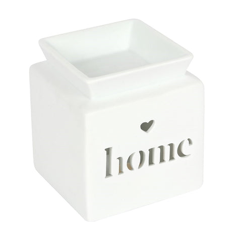 A White Cube shaped Oil and wax melt burner with text cut out home and a small heart cut out above the word home
