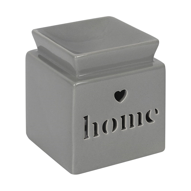 Square Oil Burner grey in colour cube with text home cut out on front face and a small heart cut out above the text, with oil or wax melt well on top