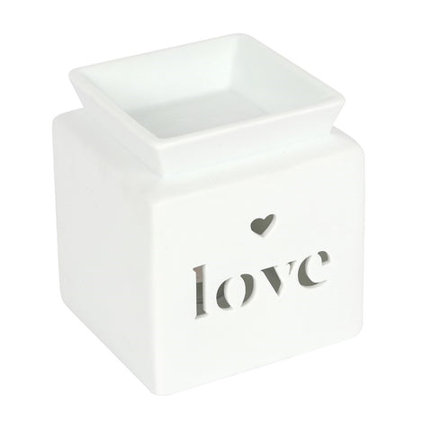 Square Oil Burner white in colour cube with text LOVE cut out on front face and a small heart cut out above the text, with oil or wax melt well on top