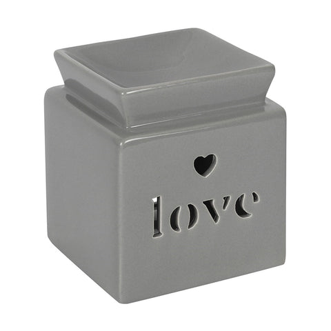 Square Oil Burner grey in colour cube with text love cut out on front face and a small heart cut out above the text, with oil or wax melt well on top