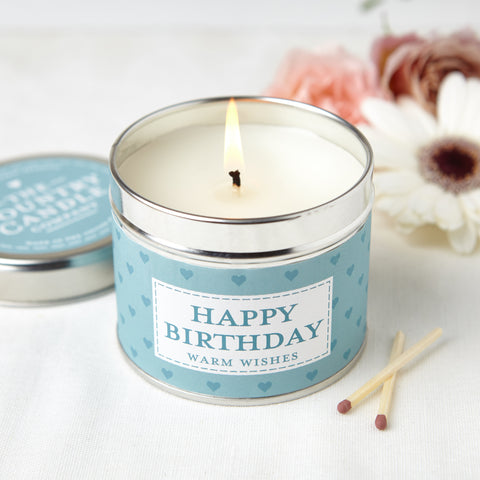 silver round tin with blue heart band labelled HAPPY BIRTHDAY with BLUE sticker on lid with writing The Country Candle Candle Company
