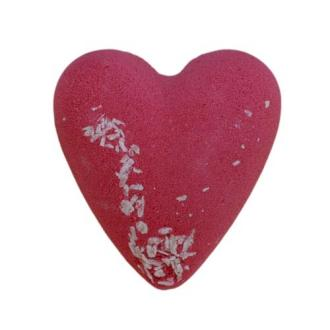 A red and white heart shaped bath bomb on white background
