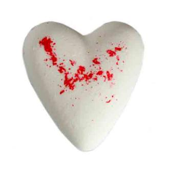 A white and red heart shaped bath bomb displayed on white background